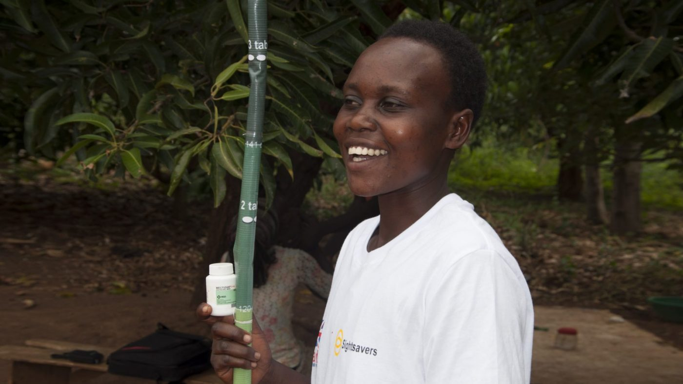 Joyce Kusiima, en frivilling samfunnsdistributør i Uganda.