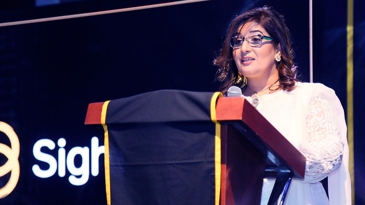 Haya Mashhood on stage at the event.
