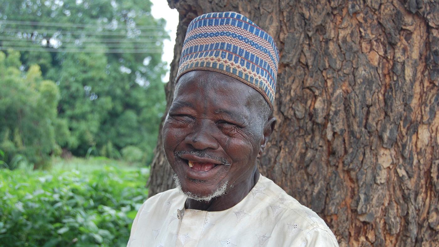 Usman smiles after receiving eye surgery.